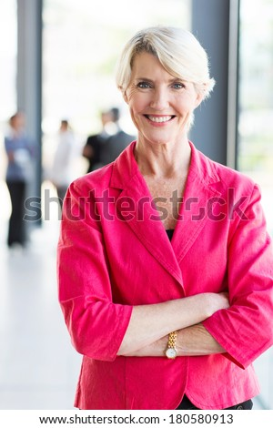 happy mature businesswoman in office - stock photo