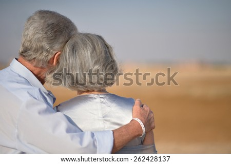 Happy Mature couple in love enjoy fresh air and stunning view on vacation - stock photo