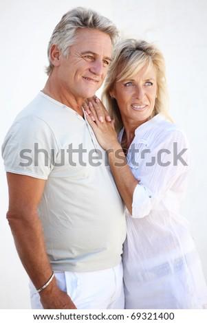 Happy mature couple smiling. - stock photo