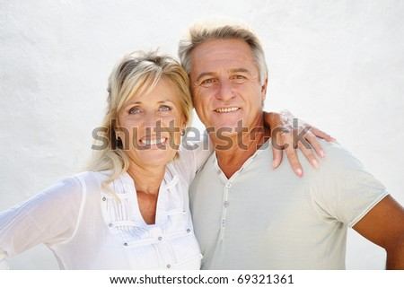 Happy mature couple smiling and embracing. - stock photo