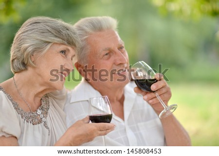 happy Mature couple together relaxing and drinking wine together - stock photo