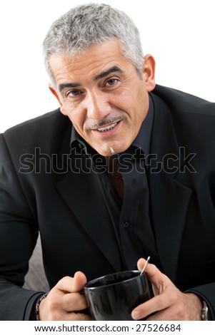 Happy mature man drinking tea, smiling, isolated on white background. - stock photo