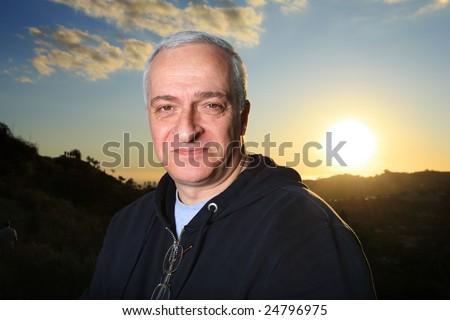 Happy mature man outdoors - stock photo