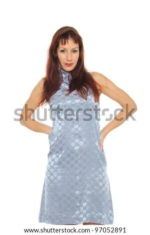 Happy mature woman in grey dress over white background - stock photo