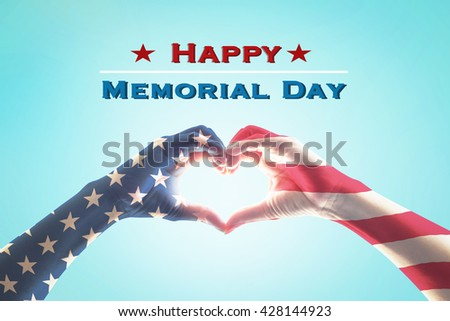 Happy memorial day text message with America flag pattern on people hands in heart shaped form on blue vintage sky background: United states of america USA national holiday day US veterans day concept - stock photo