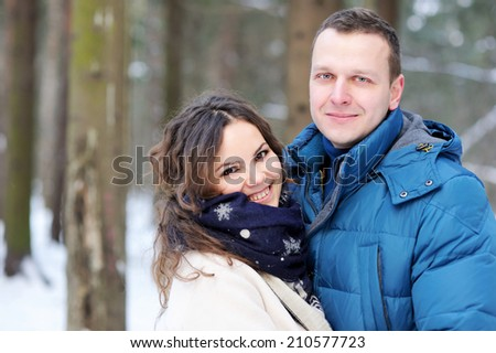 Happy middle age affectionate couple looking at camera in park  - stock photo