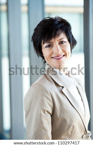 happy middle aged businesswoman portrait in office - stock photo