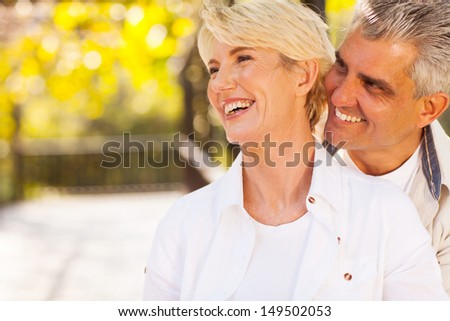happy middle aged couple outdoors - stock photo
