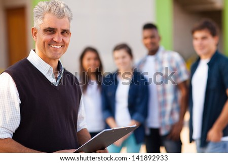 happy middle aged male high school teacher - stock photo