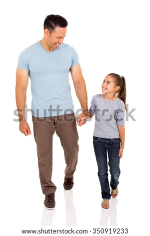 happy middle aged man and daughter walking on white background - stock photo