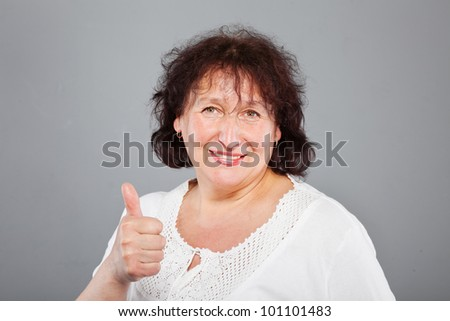 happy middle aged woman closeup portrait - stock photo