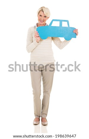 happy middle aged woman holding paper car isolated on white - stock photo