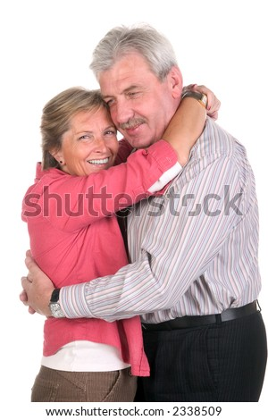 Happy middleaged couple hugging each other - stock photo