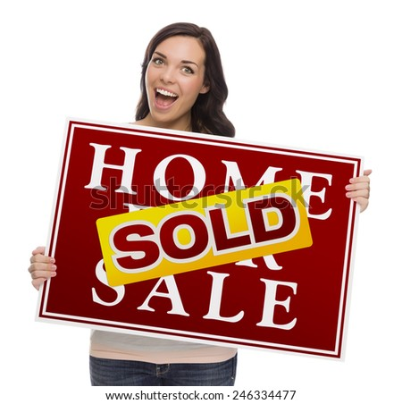 Happy Mixed Race Female with Sold Home For Sale Real Estate Sign Isolated on White. - stock photo