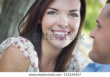 Happy Mixed Race Romantic Couple Portrait in the Park. - stock photo