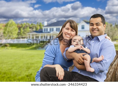 Happy Mixed Race Young Family in Front of Beautiful House. - stock photo