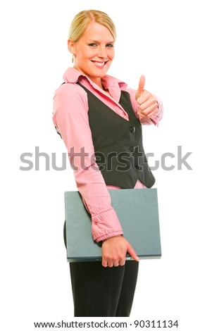 Happy modern business woman holding folder and showing thumbs up - stock photo