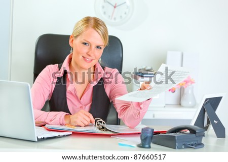 Happy modern business woman showing document - stock photo