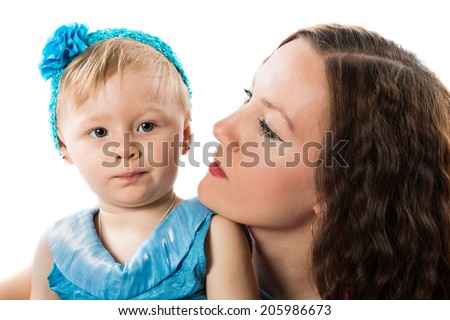 Happy mom and baby girl hugging on isolated white background - stock photo