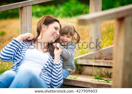 Happy mom and daughter. Mom and child girl. Happy family.  - stock photo