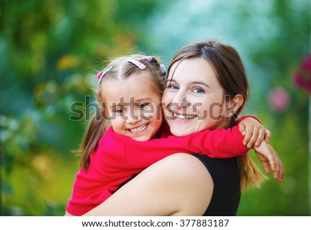 Happy mom and daughter. Mom and child girl. Happy family. Shallow depth of field. Selective focus. - stock photo