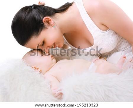 Happy mom and sleep baby, tenderness  - stock photo