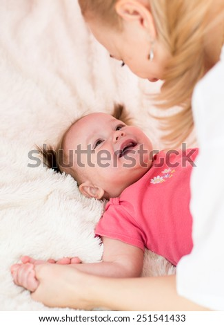 Happy mother  and baby have fun pastime at home - stock photo