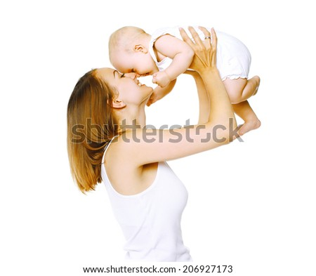 Happy mother and baby having fun - stock photo