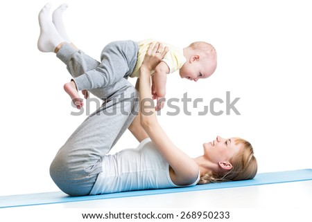 happy mother and baby making healthy gymnastics - stock photo