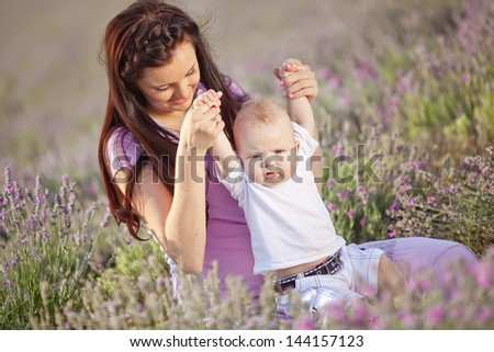 happy mother and baby on nature - stock photo