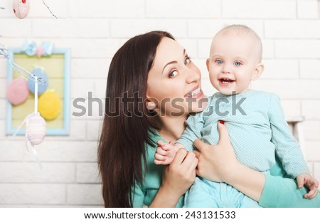 Happy mother and baby spending time together. Easter time - stock photo