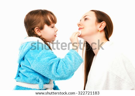 happy mother and daughter at home, daughter doing makeup to her mom, isolated against white background - stock photo