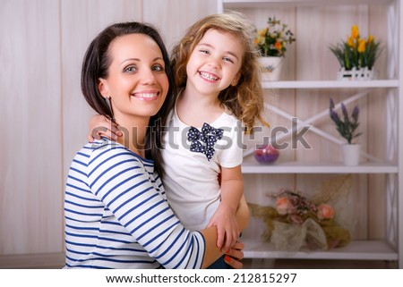 Happy mother and daughter at home. Family relationships, emotions - stock photo