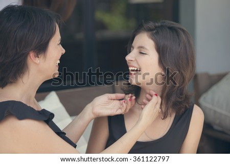 Happy mother and daughter having fun - stock photo