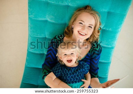 Happy mother and daughter hugging and laughing - stock photo