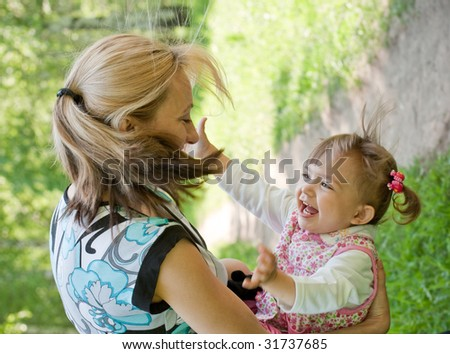 Happy mother and daughter portrait - stock photo