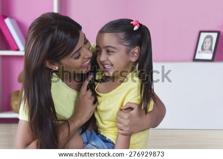 Happy mother and daughter spending leisure time at home - stock photo