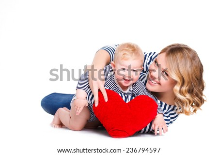 happy mother and her child with red heart, isolated against white background. childhood, parenting and relationship concept - happy mother with adorable little boy and red heart - stock photo