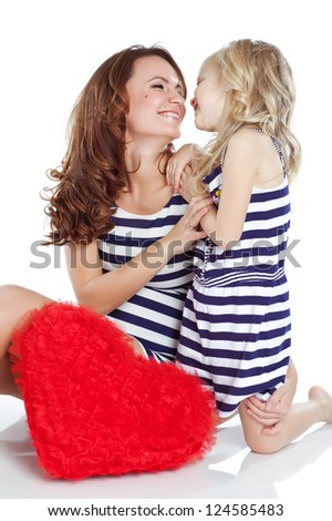 happy mother and her daughter  with big red hearts, isolated against white background - stock photo