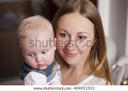 Happy mother and her little son at home - stock photo
