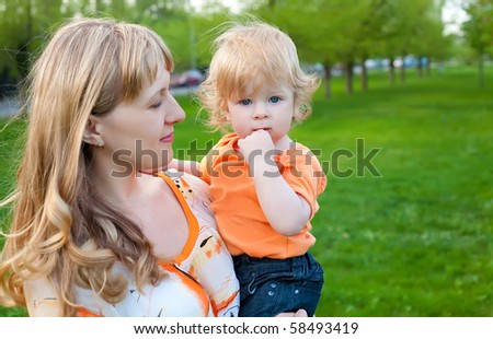 Happy mother and her little son outdoors session - stock photo