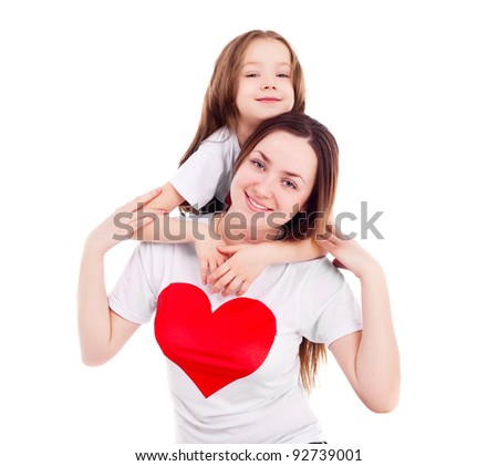 happy mother and her six year old daughter wearing T-shirts with big red hearts, isolated against white background - stock photo
