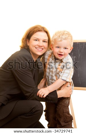Happy mother and son in front of a blackboard - stock photo