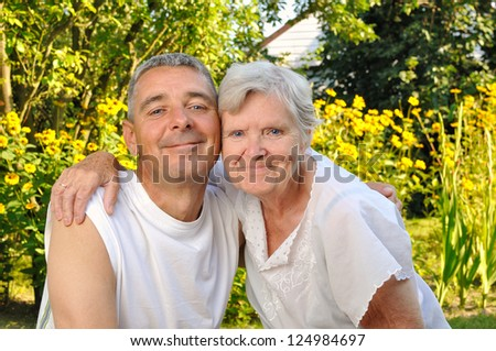 Happy mother and son in garden. - stock photo