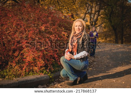 happy mother and son in the autumn park - stock photo
