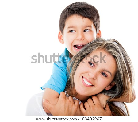 Happy mother and son looking up - isolated over white - stock photo