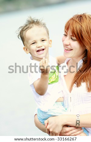 happy mother and son outdoors - stock photo