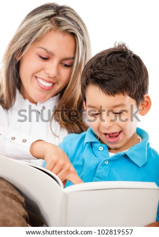 Happy mother and son reading a book - isolated over a white background - stock photo