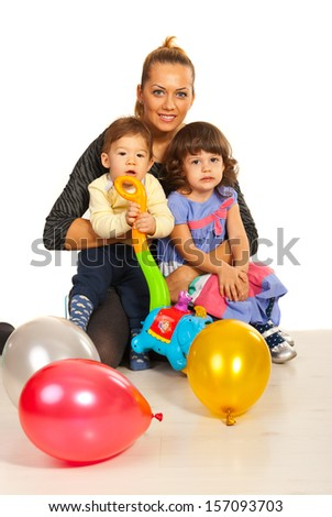 Happy mother embracing her kids  against white background - stock photo