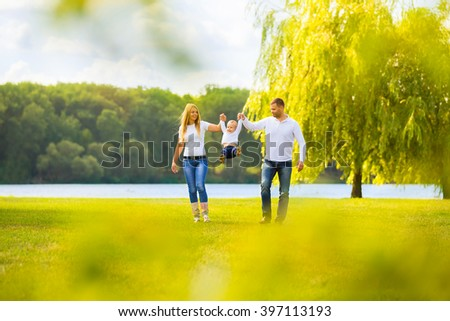 happy mother,father and son on a walk on a Sunny day - stock photo